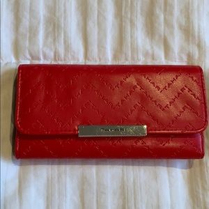 Tahari red wallet with identity protect lining.